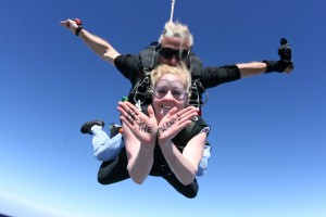 Young professional Sarah jumps out of a plane for Opportunity Tanzania.