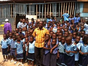 George Owusu Asare and students of the King George International School in Ashaiman.